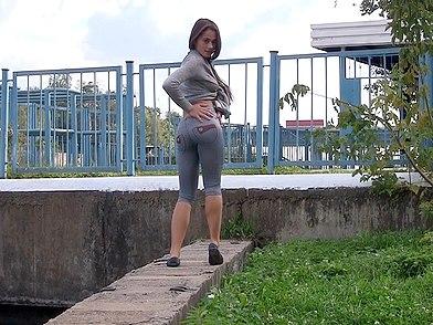 brunette hot girl in tight jeans